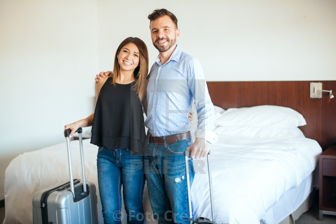"""Newlyweds arriving to their hotel room"" stock image"