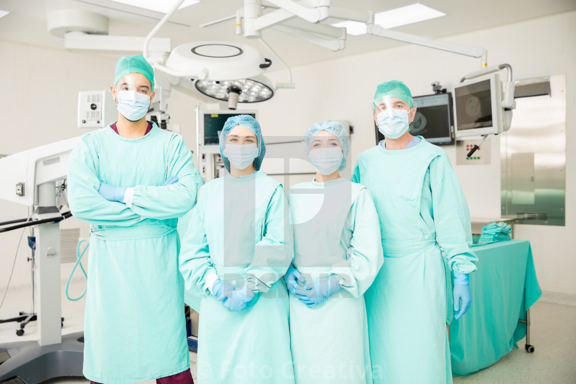 """Group of surgeons in an OR"" stock image"