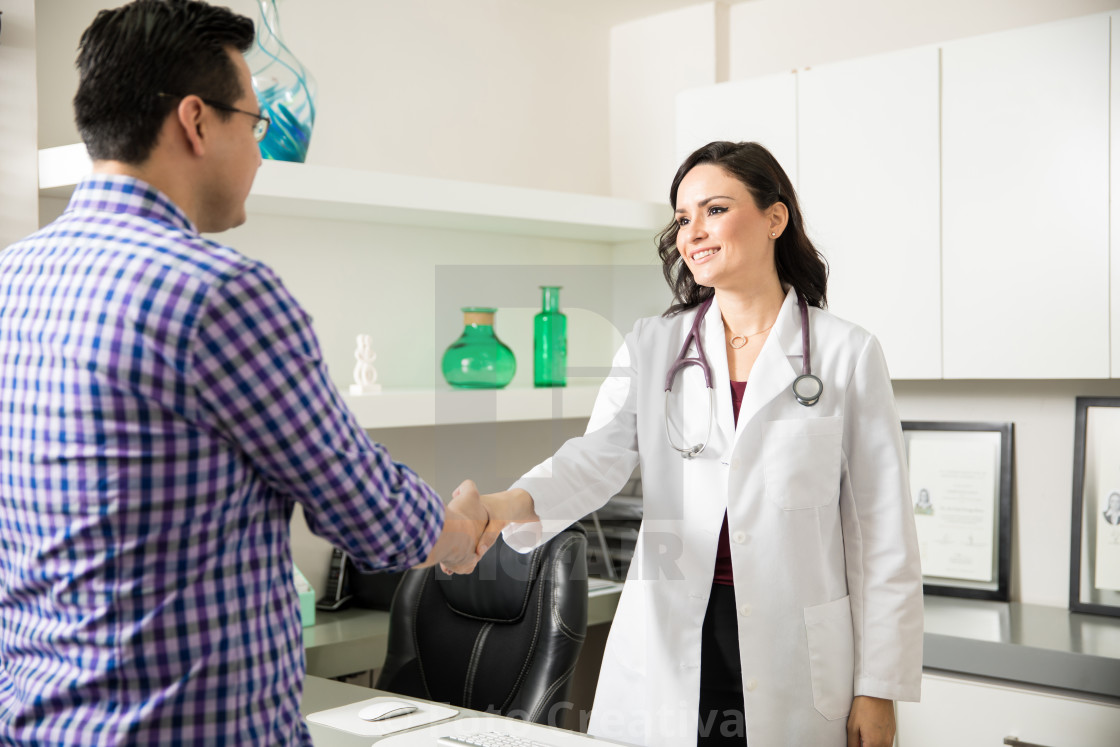"""Female doctor greeting a patient"" stock image"