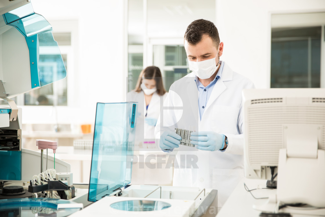"""Hispanic chemists working in a lab"" stock image"