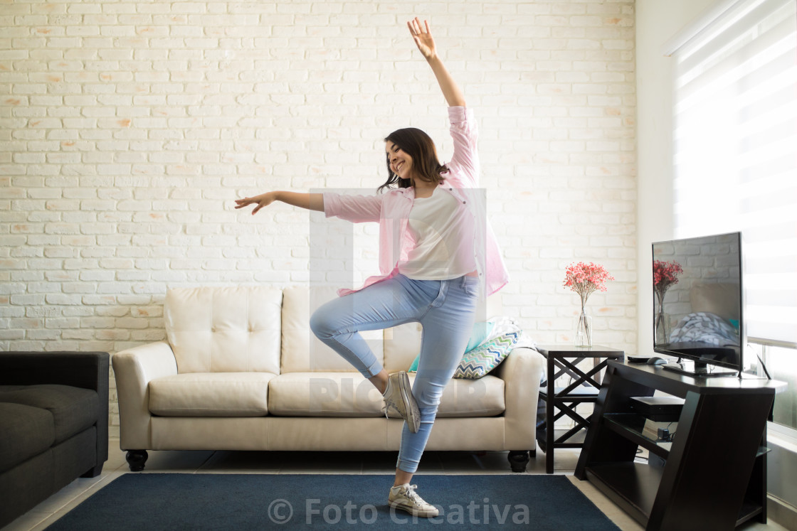 """Single woman dancing in the new apartment"" stock image"