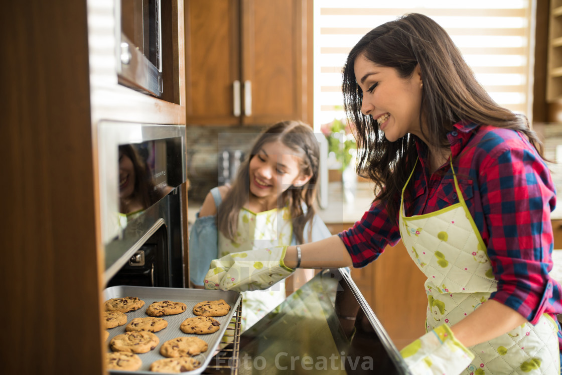 """Mom and daughter just baked some cookies"" stock image"