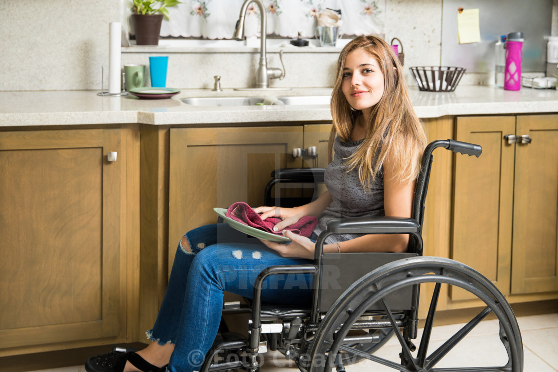 """Disabled woman doing house chores"" stock image"