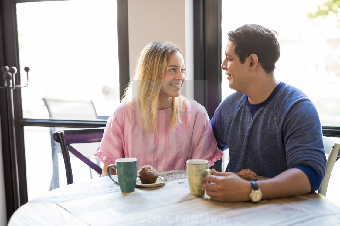 """Good looking young couple in love at restaurant"" stock image"