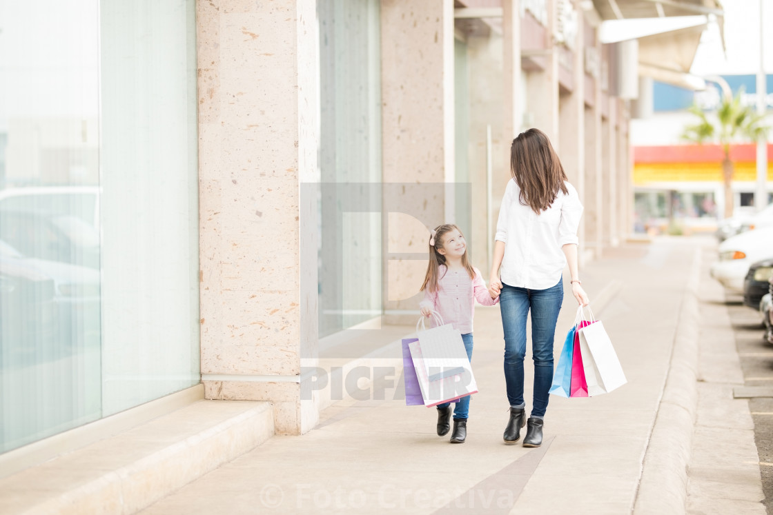 """Rich mother and daughter on a shopping spree"" stock image"