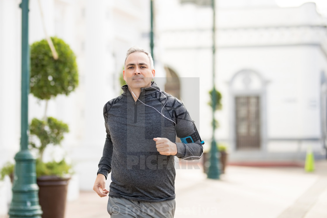 """Active mature man jogging in the city"" stock image"
