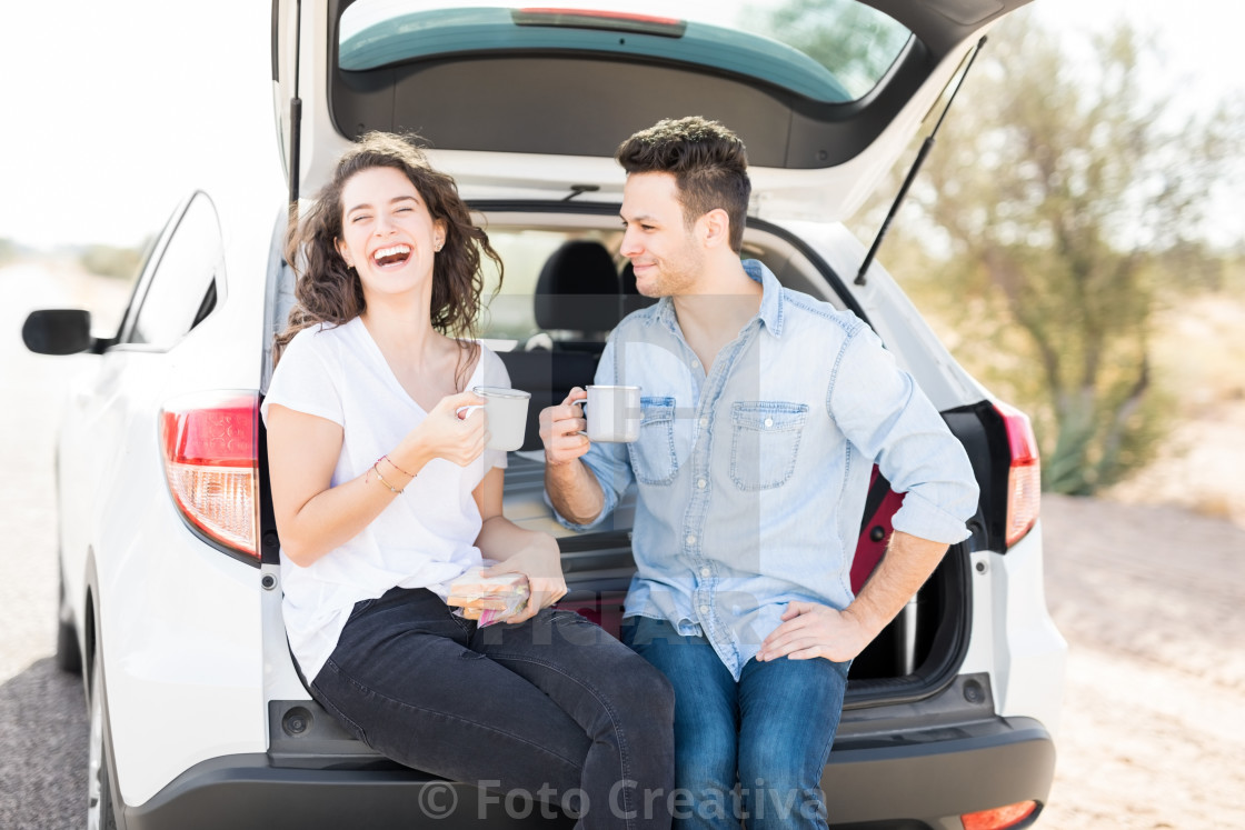 """Couple having a great time on road trip"" stock image"