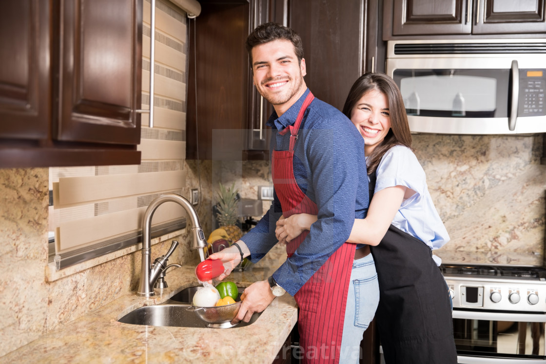 """Lovely couple in kitchen preparing food"" stock image"