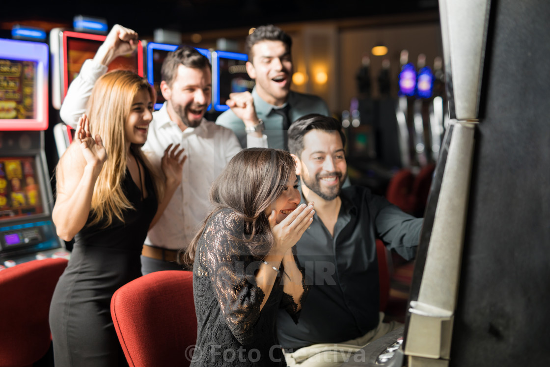 """Excited woman winning in a casino"" stock image"