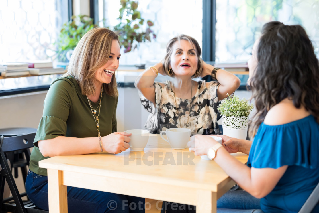 """Friends enjoying at coffee shop"" stock image"