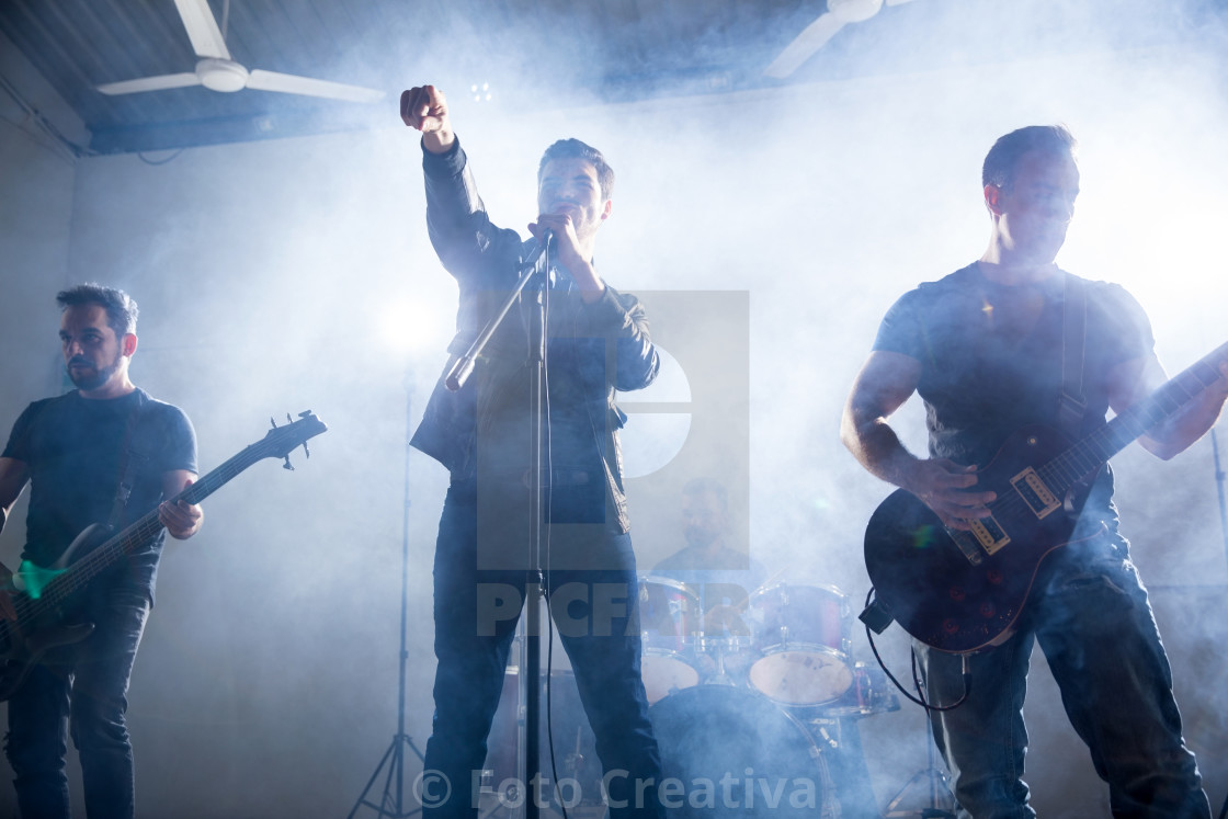 """Rock band playing on a concert"" stock image"