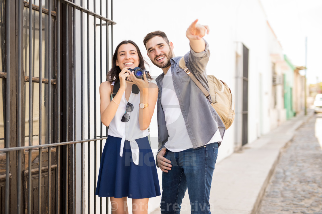 """Cheerful couple laughing and enjoying clicking photos"" stock image"