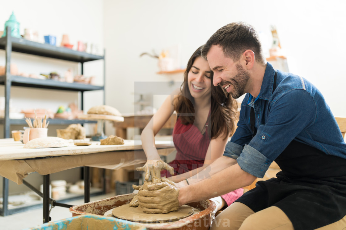 """Couple Showing Their Creativity While Dating In Pottery Class"" stock image"