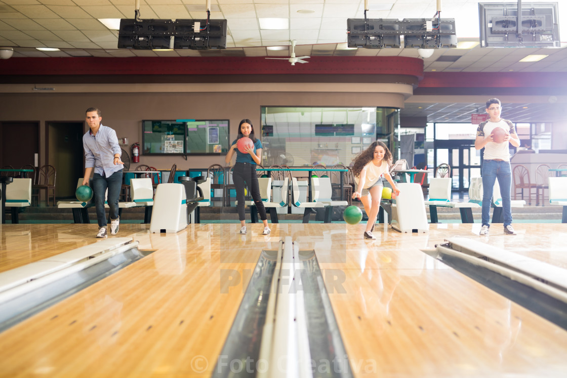 """Teens Having A Good Time While Bowling In Club"" stock image"