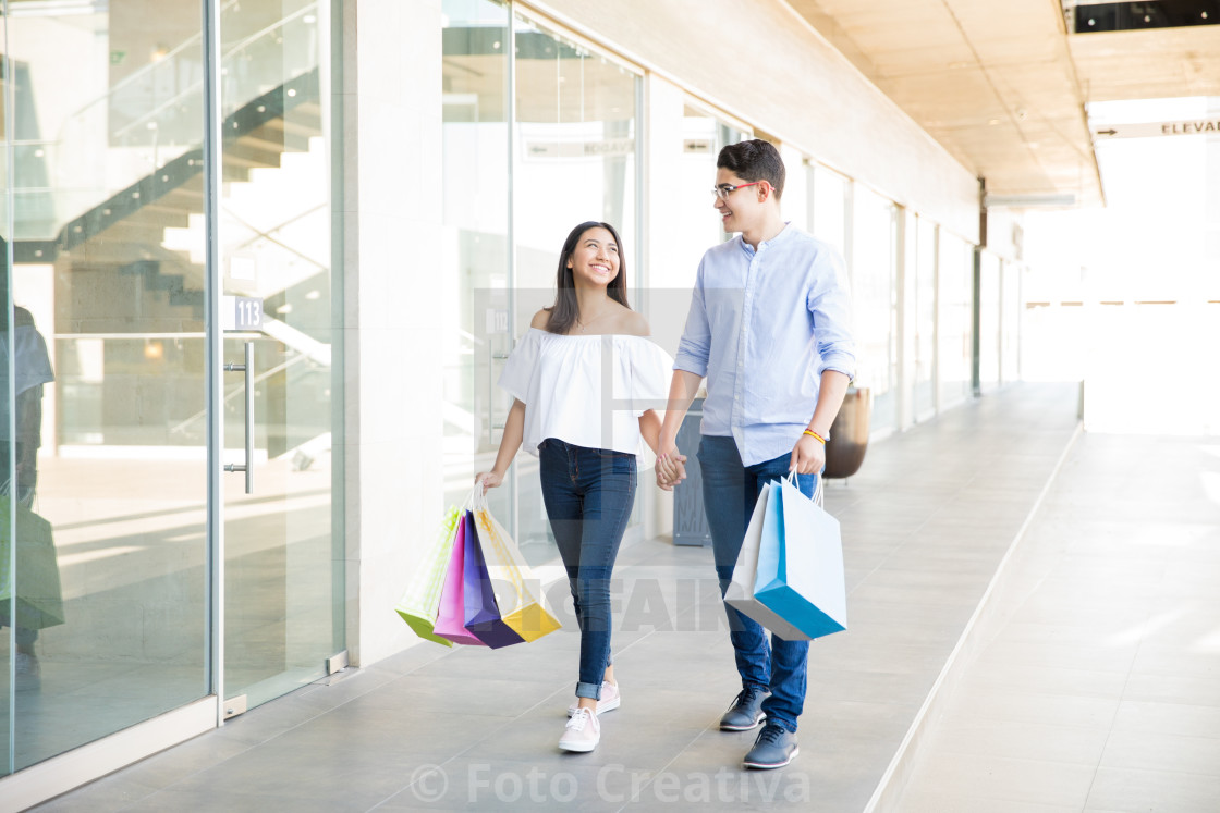 """Lovers With Bags Spending Weekend Shopping In Mall"" stock image"