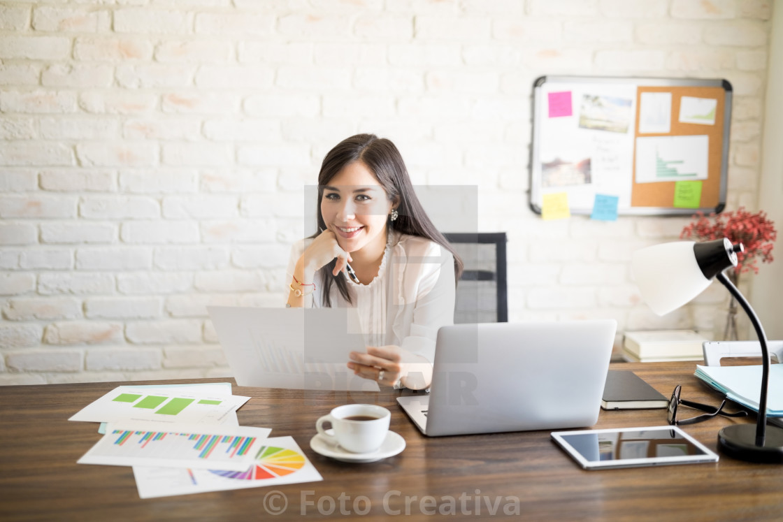 """Accountant studying annual reports"" stock image"