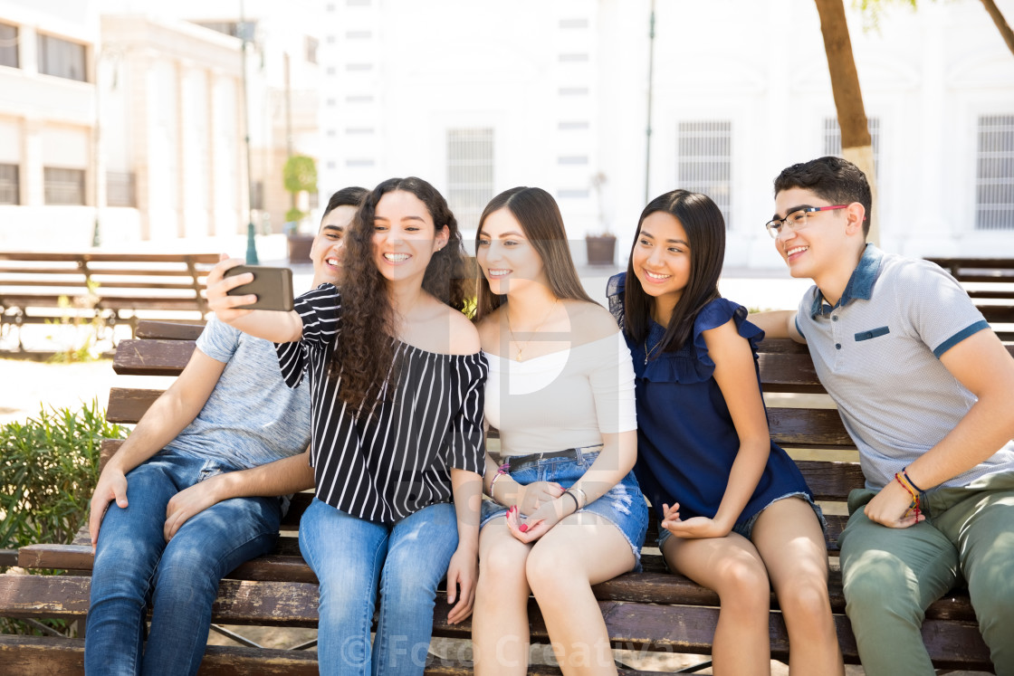 """Friends posing for a selfie"" stock image"