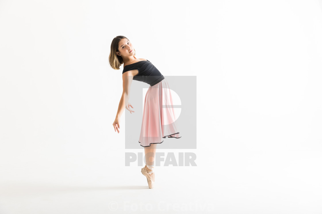 """Ballerina Performing Backbend On White Background"" stock image"
