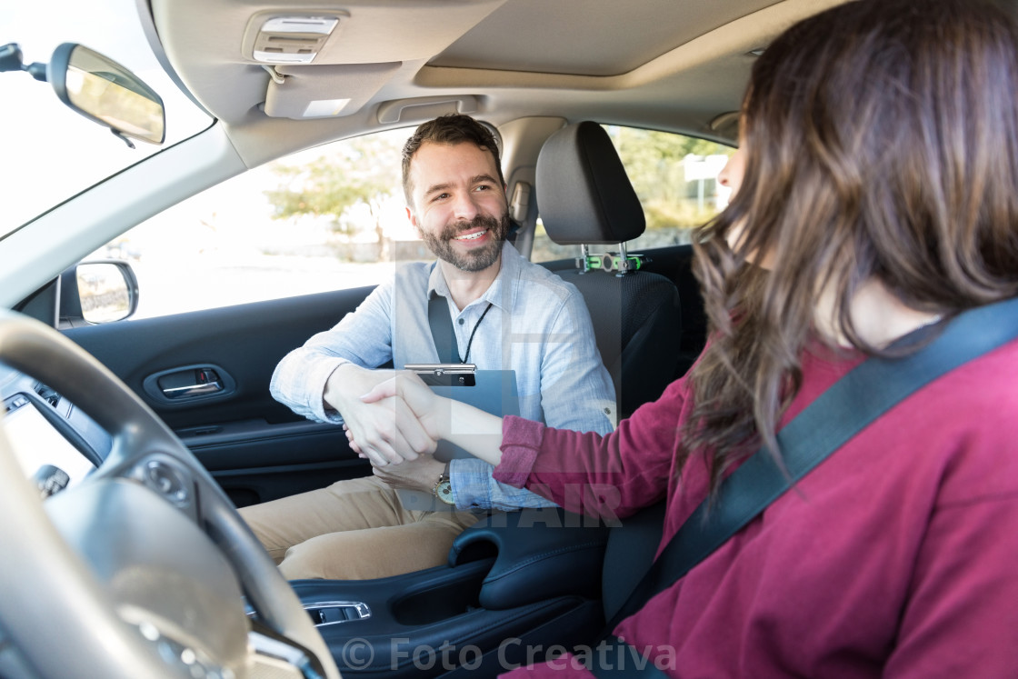 """Giving Self Introduction With A Handshake In Car"" stock image"