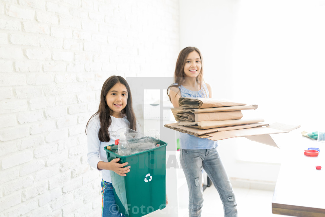 """Confident Girls Organizing Waste"" stock image"