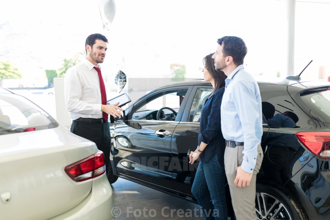 """Couple Listening To Car Salesman With Trust"" stock image"