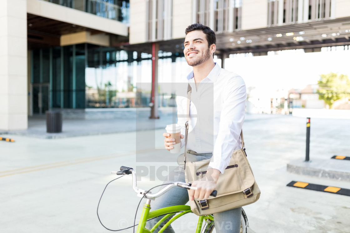 """Smiling Executive With Coffee And Cycle On Street"" stock image"