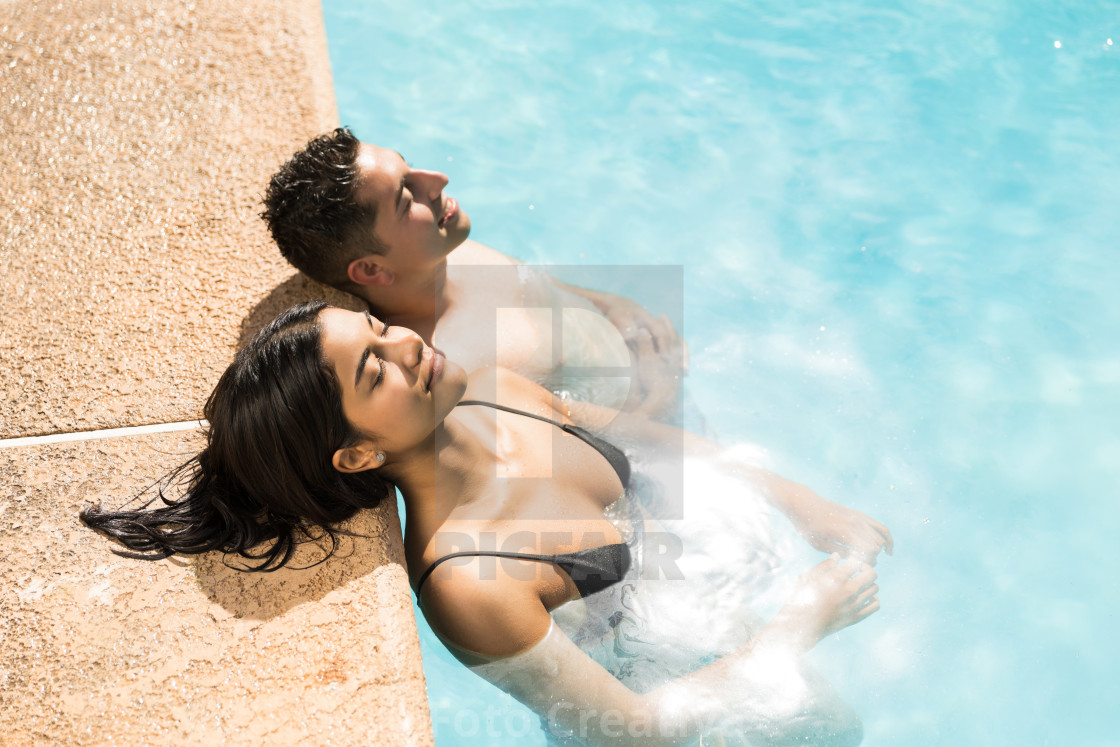 """Couple Enjoying In Pool During Vacation"" stock image"