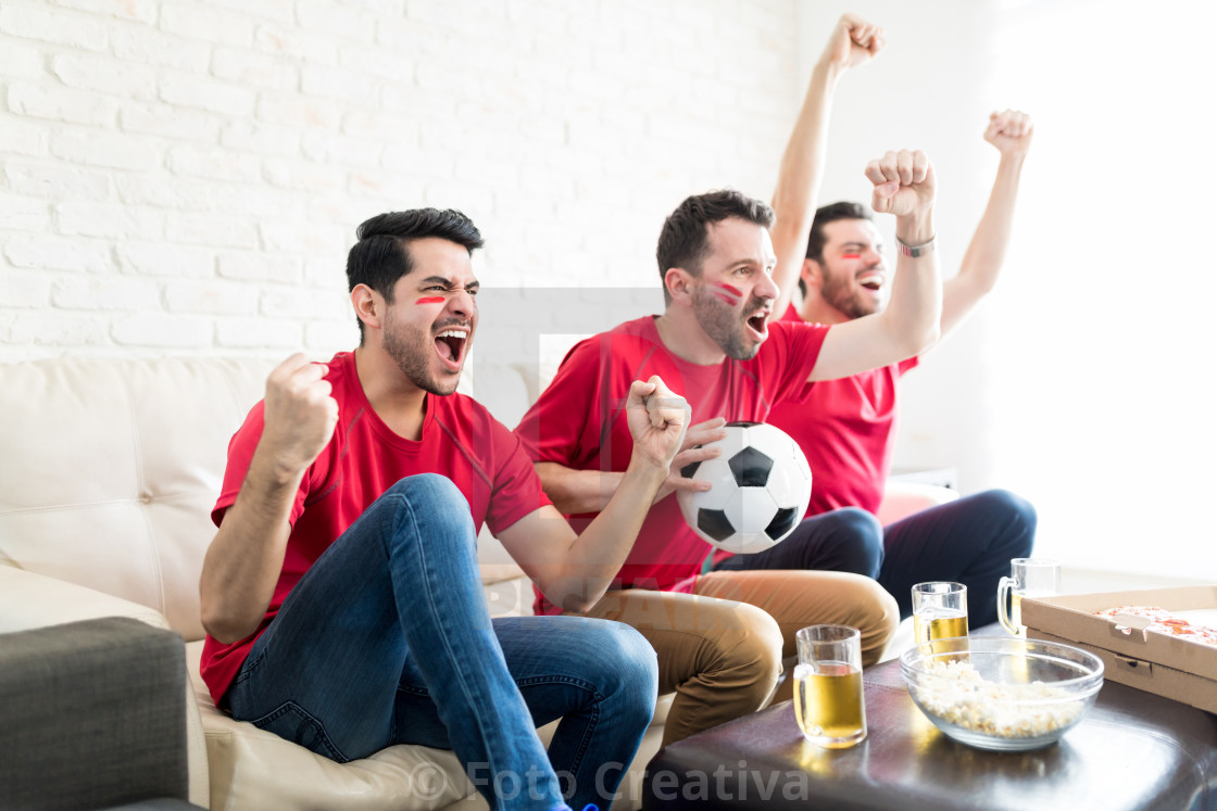 """Fans On Cloud Nine As Their Team Wins The Match"" stock image"