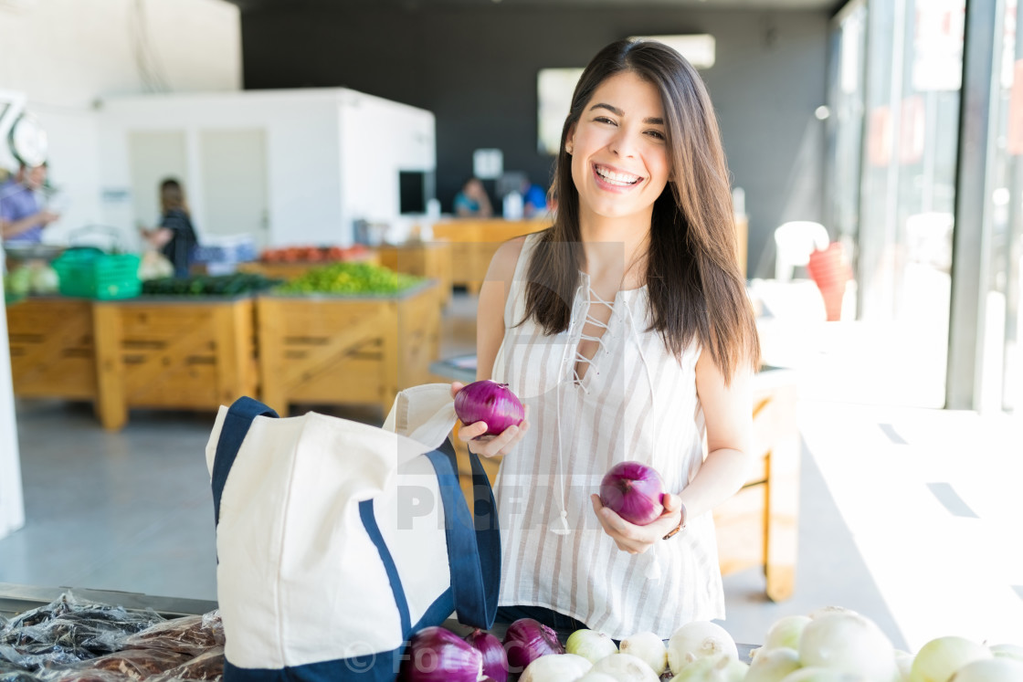 """Woman Purchasing Healthy Vegetables In Market"" stock image"
