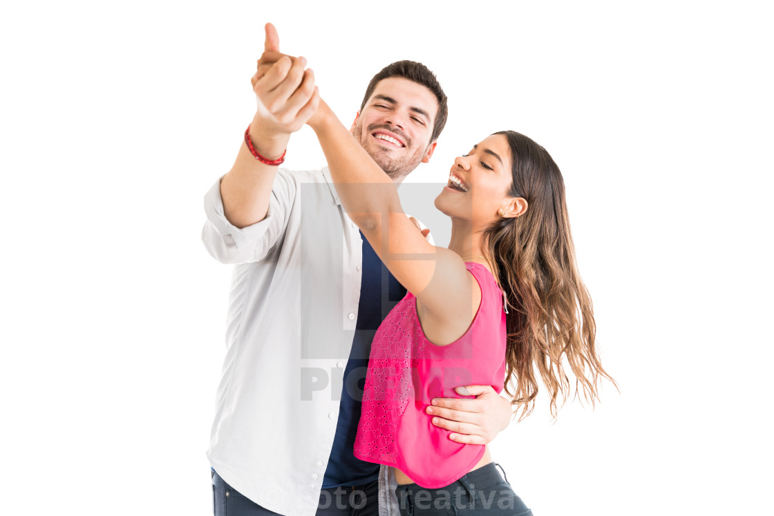 """Woman And Man Enjoying Dance Against Plain Background"" stock image"