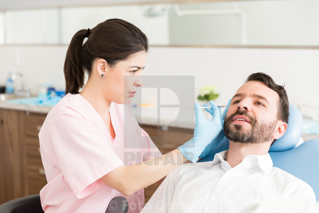 """Man Taking Pain To Improve Appearance"" stock image"
