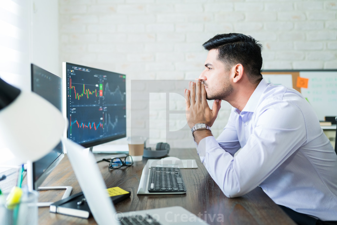 """Attractive Male Finance Professional Concentrating On Trading"" stock image"