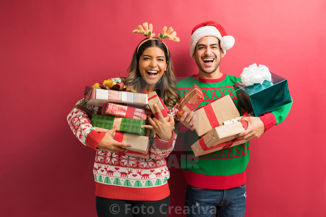"""Young Woman And Man With Gift Boxes"" stock image"