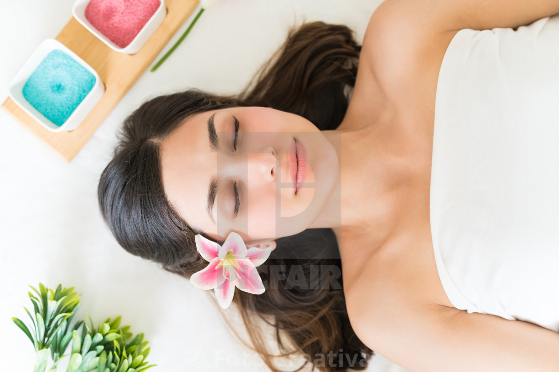 """Pretty Female Lying With Flower On Bed"" stock image"