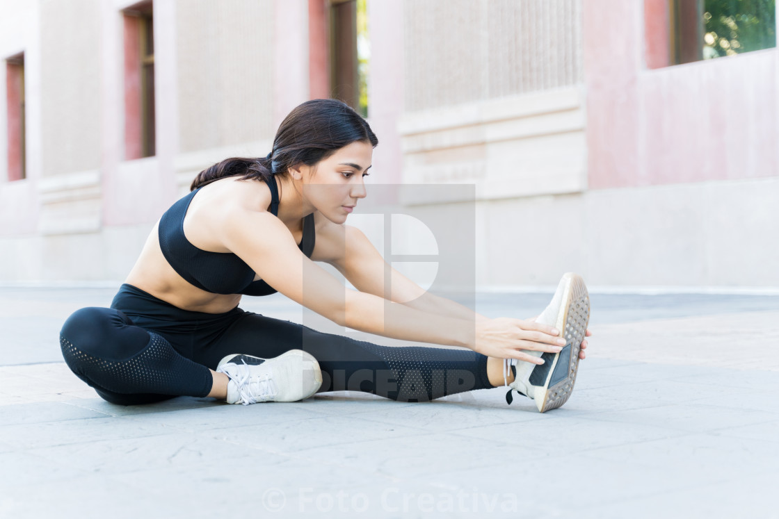 """Pretty Female Athlete Working Out In City"" stock image"