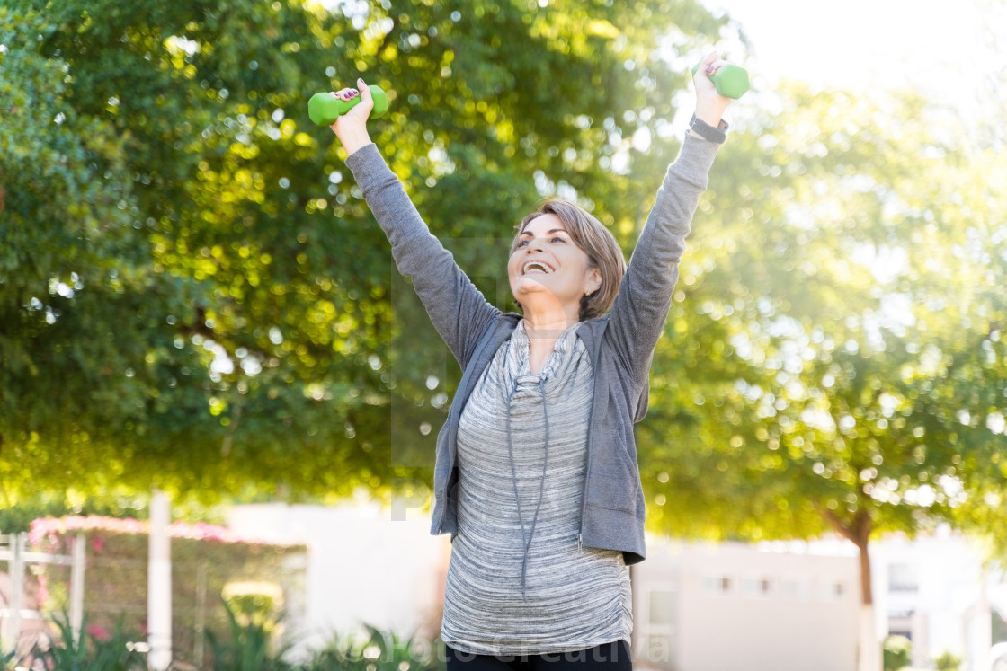 """Elderly Woman Exercising With Arms Raised"" stock image"