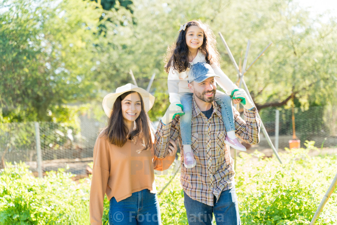 """Happy Parents With Daughter At Vegetable Garden"" stock image"