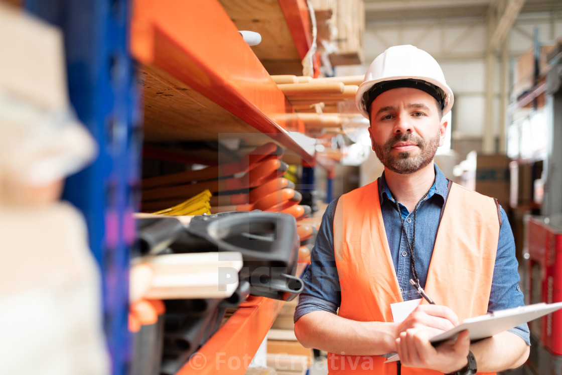 """Good Looking Supervisor Standing With List At Factory"" stock image"
