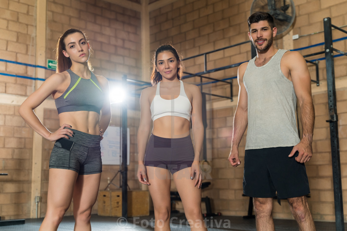 """Portrait Of Friends Standing At Gym"" stock image"
