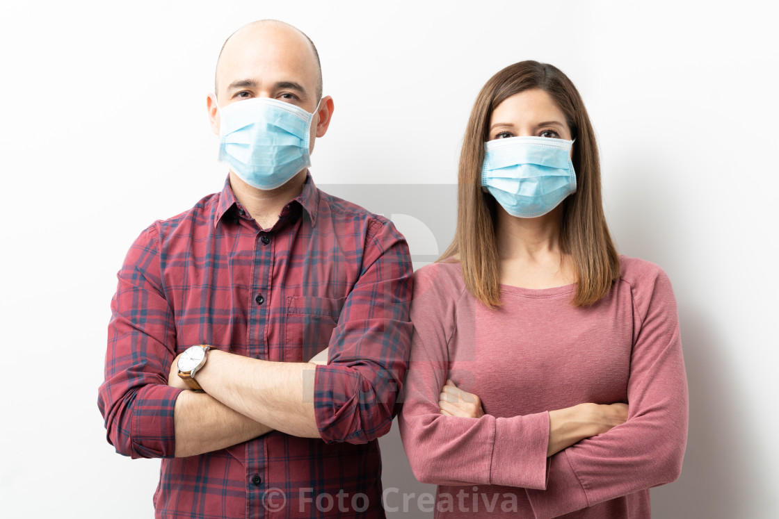 """Caucasian couple wearing surgical masks"" stock image"