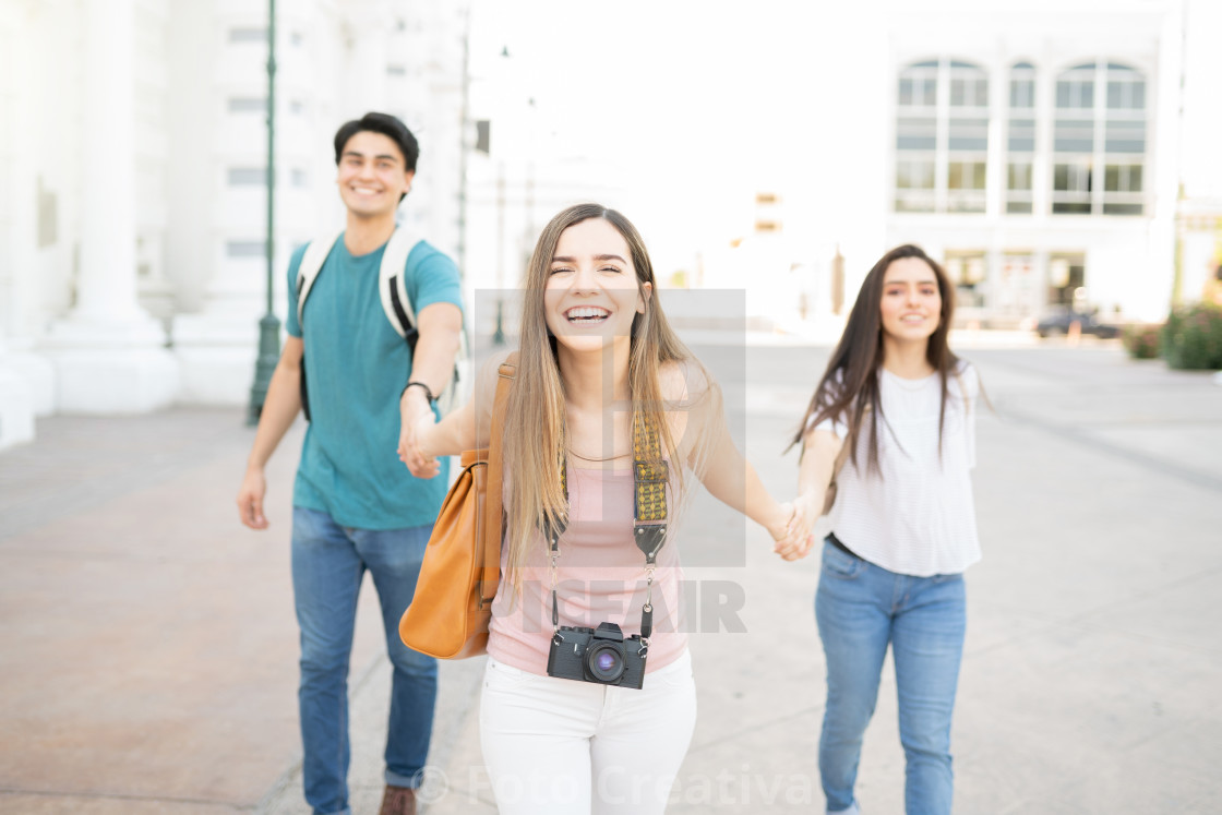 """Cheerful Man And Women Exploring City"" stock image"