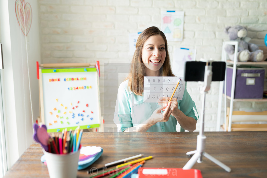 """Woman teaching kindergarten from home"" stock image"