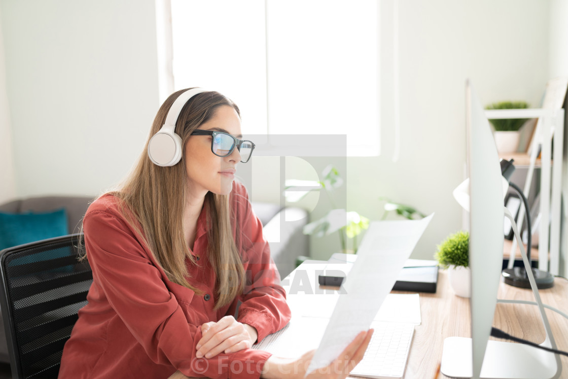 """Woman working with headphones on"" stock image"