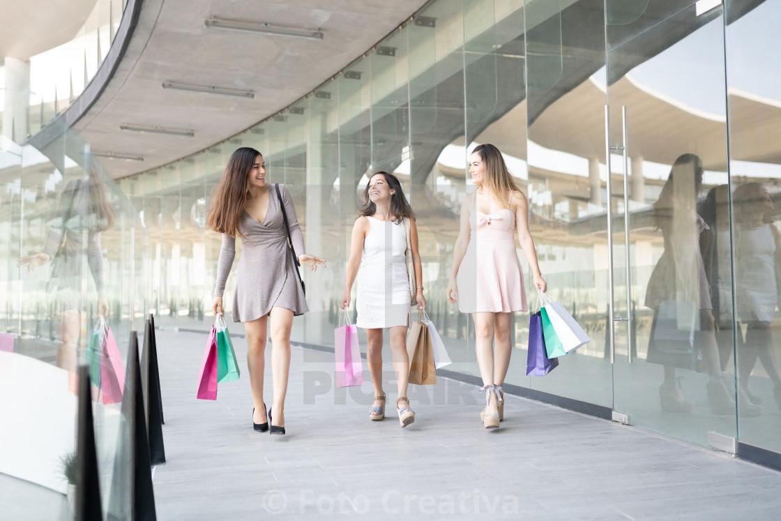 """Women Enjoying Shopping In Mall During Weekend"" stock image"