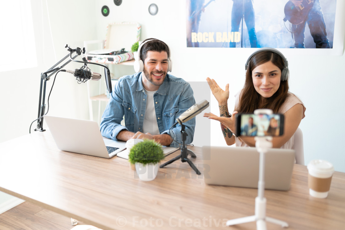 """Announcer introducing her podcast guest"" stock image"