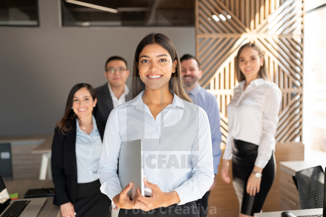 """Confident hispanic business woman in office"" stock image"