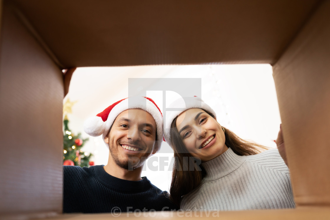 """Looking inside a Christmas present"" stock image"