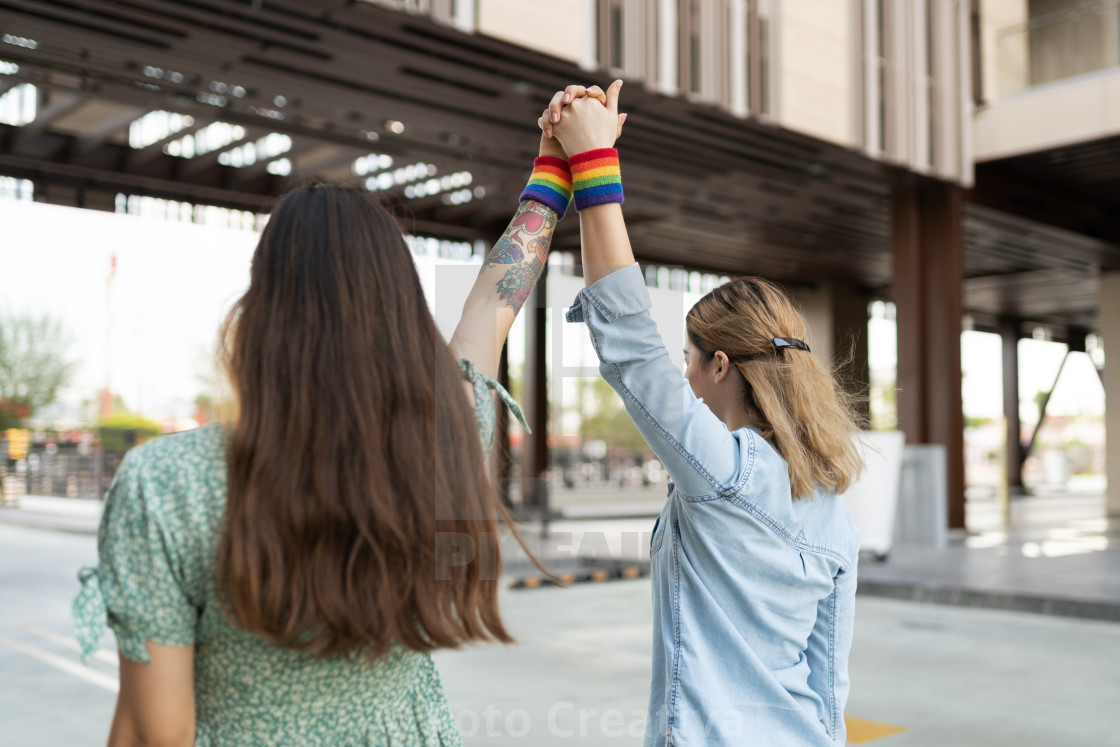 """Gay young couple supporting LGBT rights"" stock image"