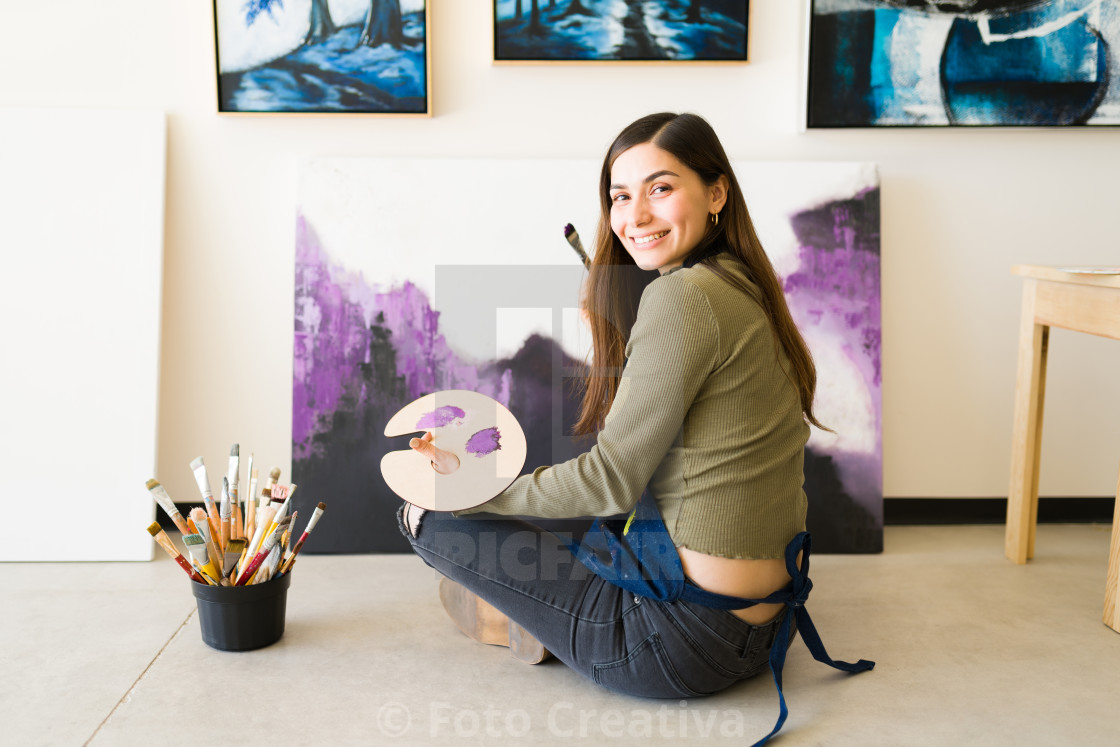 """Happy female artist doing a big painting for an art exhibition"" stock image"