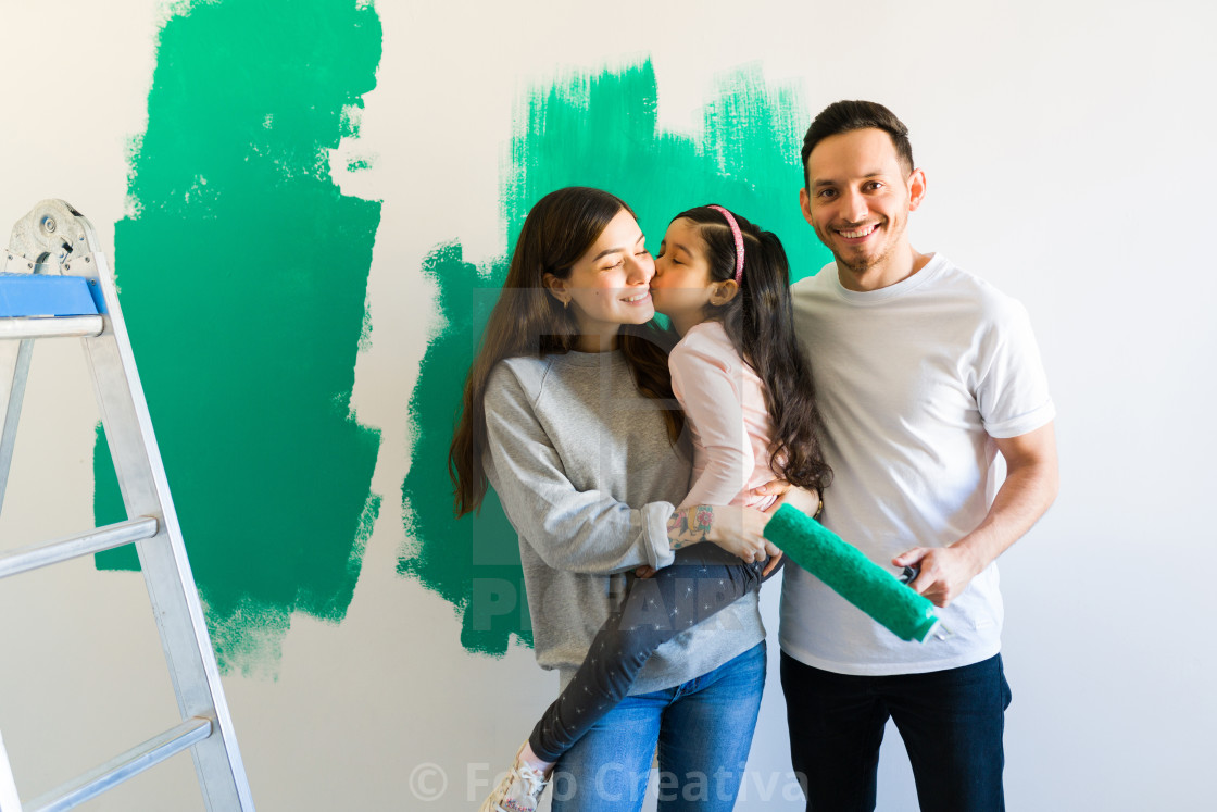 """Loving family doing a painting project in their home"" stock image"
